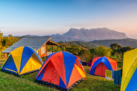 Camping tents on Mountaintop during sunrise