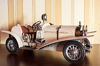 White classic car model over brown stripped wallpa