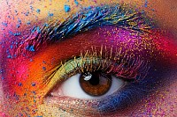 Female eye with bright multicolored fashion makeup