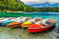 boats on the crystal clear alpine lake,Lake Fusine