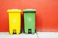 Large green and yellow wheelie bins for Recycle