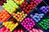 Colored pens on shelves In the shop