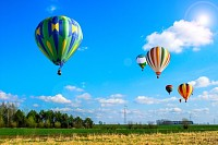 Air balloons flew over the spring fields