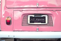 just married sign on pink classic vintage van