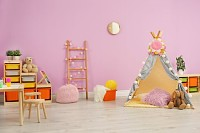 Modern nursery room interior with play tent