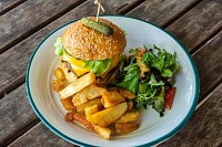 Gourmet cheeseburger with French fries and salad