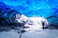 Traveler in ice cave, Vatnajokull National Park