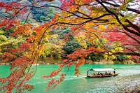 Arashiyama in autumn along the river in Kyoto