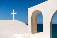 White roof of a chapel on Santorini Island, Greece
