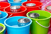 Colorful plastic buckets with water