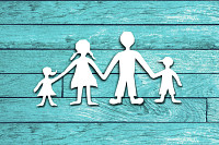 Happy family paper cut on wood background