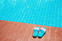 Slippers near the swimming pool