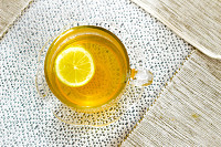 Above view of a glass of tea with lemon slice on a