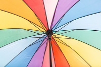 Under the colorful umbrella, rainbow background