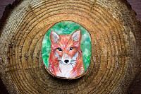 Painted forest animal on a cut piece of wood. Beau