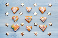 Gingerbread cookies on blue wooden background