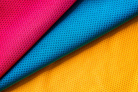 Red, blue and yellow jersey fabric texture backgro