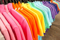 Fashion clothes on clothing rack - bright colorful