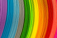 Paper strips in rainbow colors as a colorful backd