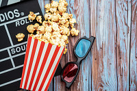 Cinema movie items, clapperboard, pop corn and 3d