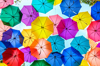 Multi-colored umbrellas background. Colorful umbre