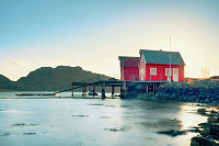 Norwegian coast landscape with a typical red house