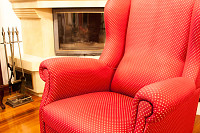 Red decorated baroque style armchair in living roo