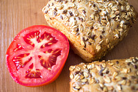 Composition of whole grain bread buns and tomato o