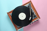 Vinyl player on a blue pink pastel background. Top