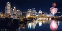 a view of Pittsburgh by night