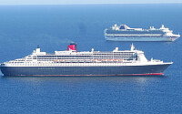 Queen Mary 2 anchored in Weymouth Bay with P O Cru
